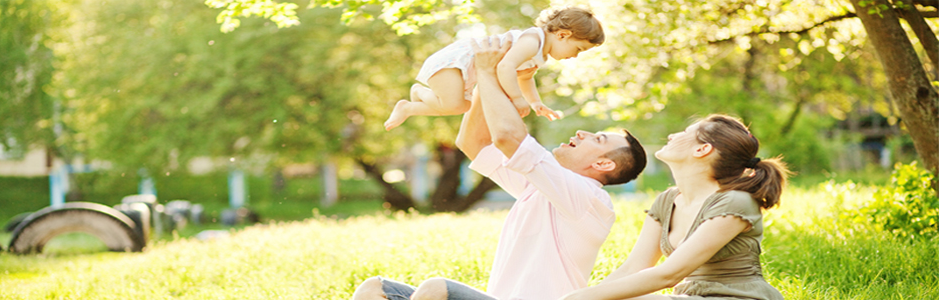 man holding baby in the air